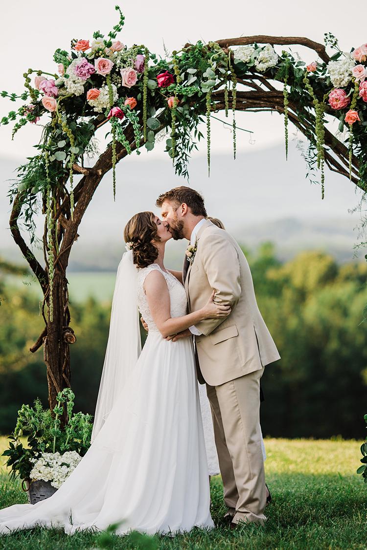 wedding ceremony kiss - photo by Amilia Photography http://ruffledblog.com/heart-touching-north-carolina-nursery-wedding