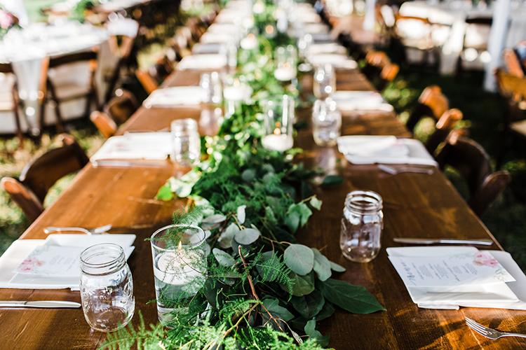 wedding tables with greenery - photo by Amilia Photography http://ruffledblog.com/heart-touching-north-carolina-nursery-wedding