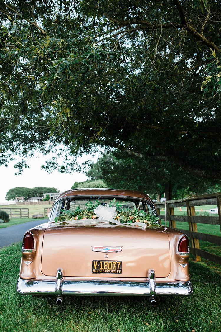 vintage getaway cars - photo by Amilia Photography http://ruffledblog.com/heart-touching-north-carolina-nursery-wedding