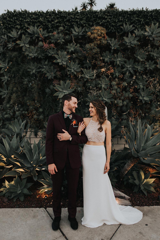 burgundy groom suit and crop top beaded wedding dress
