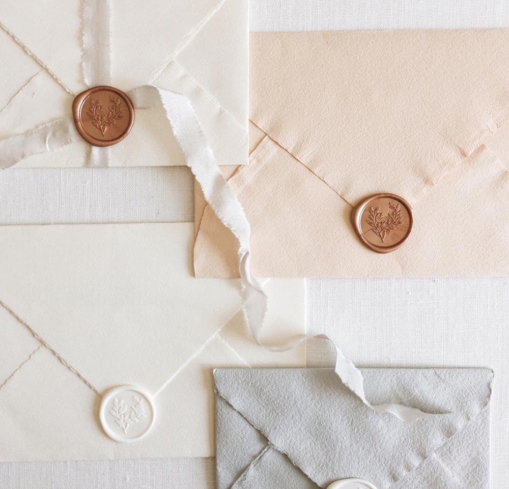 pastel wedding envelopes with wax seals