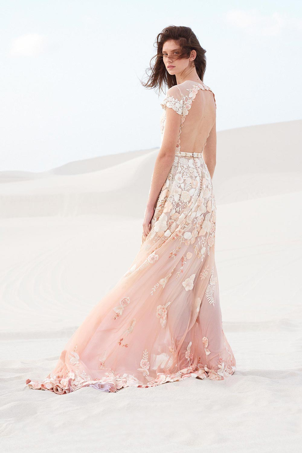 blush backless wedding dress with white floral appliqués