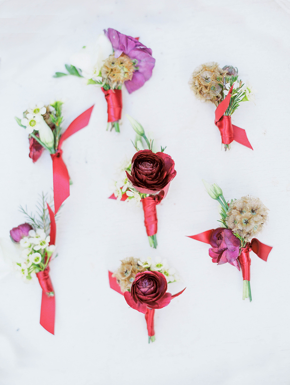 boutonnieres with ribbon - photo by Honey Gem Creative http://ruffledblog.com/hill-country-garden-wedding