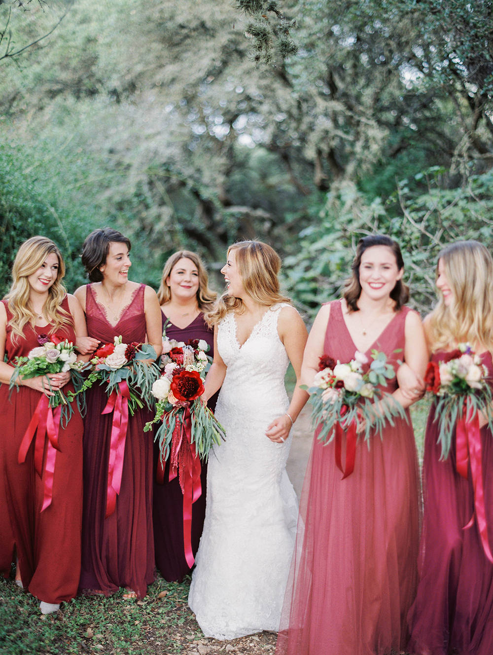 red bridesmaid dresses - photo by Honey Gem Creative https://ruffledblog.com/hill-country-garden-wedding