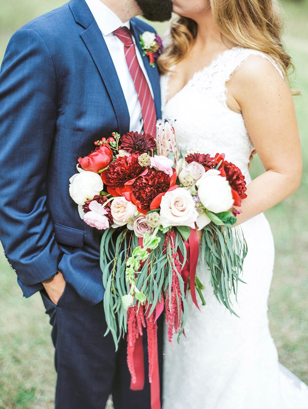 bouquets with hanging amaranthus - photo by Honey Gem Creative https://ruffledblog.com/hill-country-garden-wedding