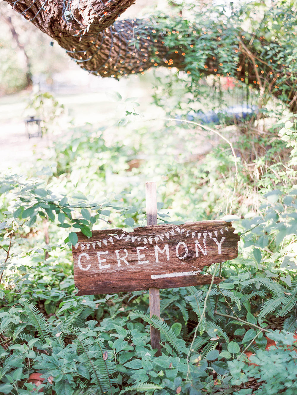 ceremony signs - photo by Honey Gem Creative https://ruffledblog.com/hill-country-garden-wedding