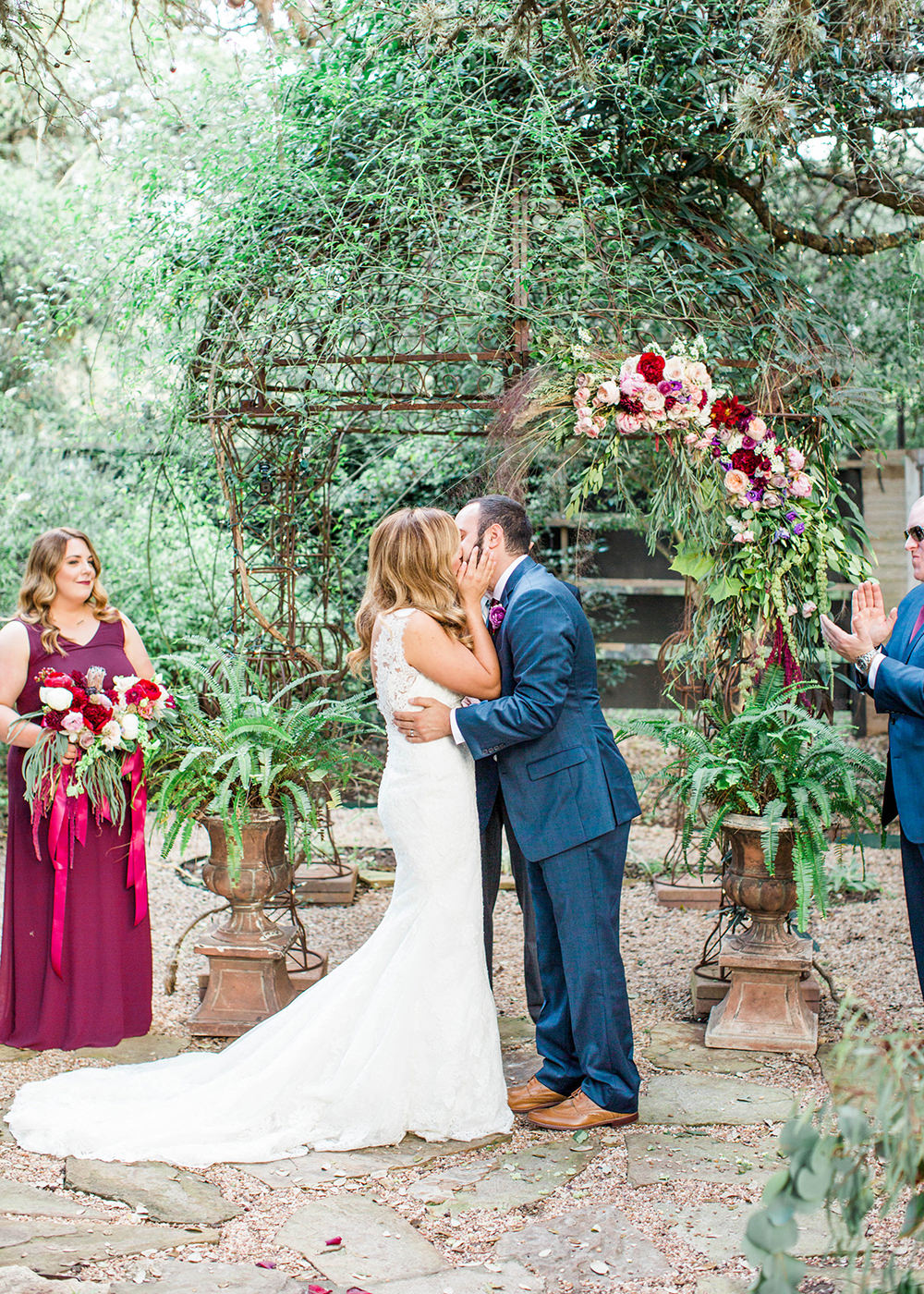 ceremony kiss - photo by Honey Gem Creative https://ruffledblog.com/hill-country-garden-wedding