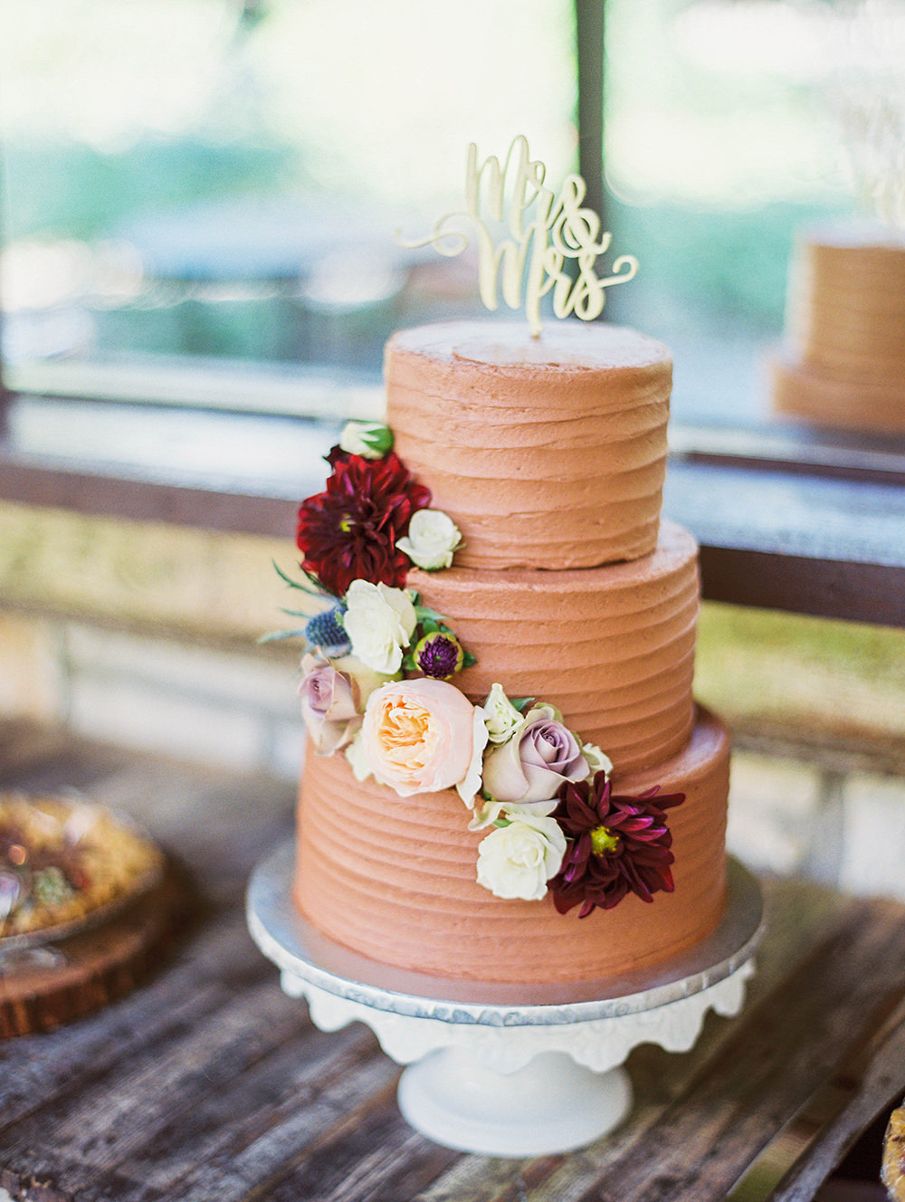chocolate wedding cakes - photo by Honey Gem Creative http://ruffledblog.com/hill-country-garden-wedding
