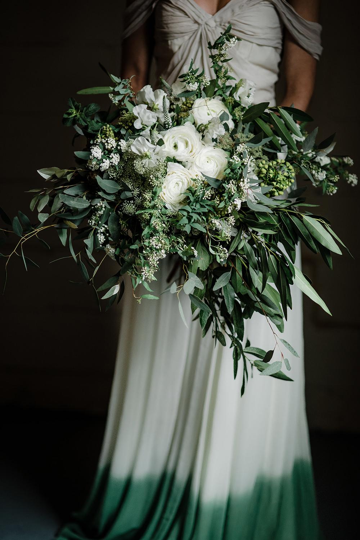 lush greenery bouquets - photo by Dawn Derbyshire Photography https://ruffledblog.com/industrial-candlelit-wedding-inspiration