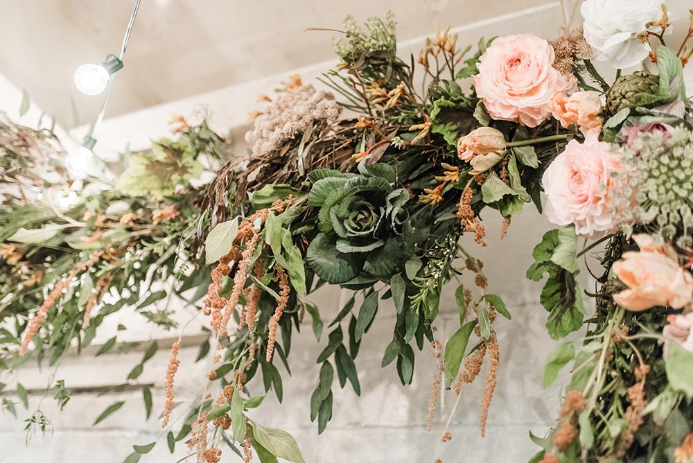 wedding flowers - photo by Dawn Derbyshire Photography https://ruffledblog.com/industrial-candlelit-wedding-inspiration