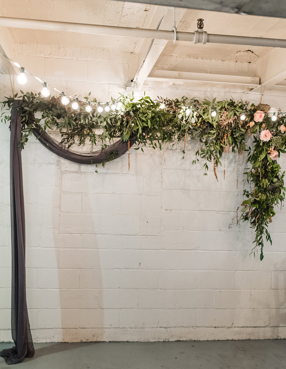 greenery arches - photo by Dawn Derbyshire Photography https://ruffledblog.com/industrial-candlelit-wedding-inspiration
