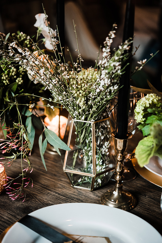 wedding centerpieces - photo by Dawn Derbyshire Photography https://ruffledblog.com/industrial-candlelit-wedding-inspiration