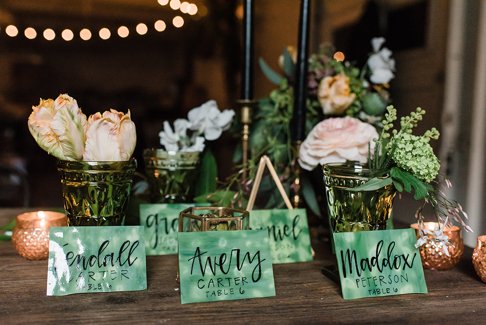 green place cards - photo by Dawn Derbyshire Photography https://ruffledblog.com/industrial-candlelit-wedding-inspiration