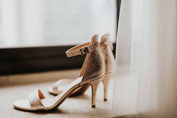 gold wedding shoes - photo by By Amy Lynn Photography https://ruffledblog.com/industrial-loft-wedding-with-a-geometric-ceremony-backdrop