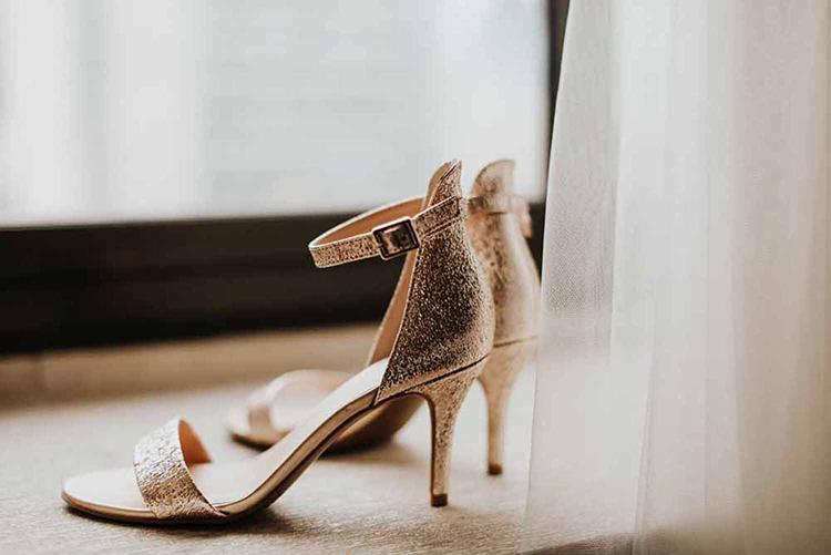 gold wedding shoes - photo by By Amy Lynn Photography http://ruffledblog.com/industrial-loft-wedding-with-a-geometric-ceremony-backdrop