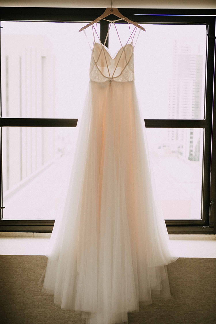 romantic wedding dresses - photo by By Amy Lynn Photography http://ruffledblog.com/industrial-loft-wedding-with-a-geometric-ceremony-backdrop