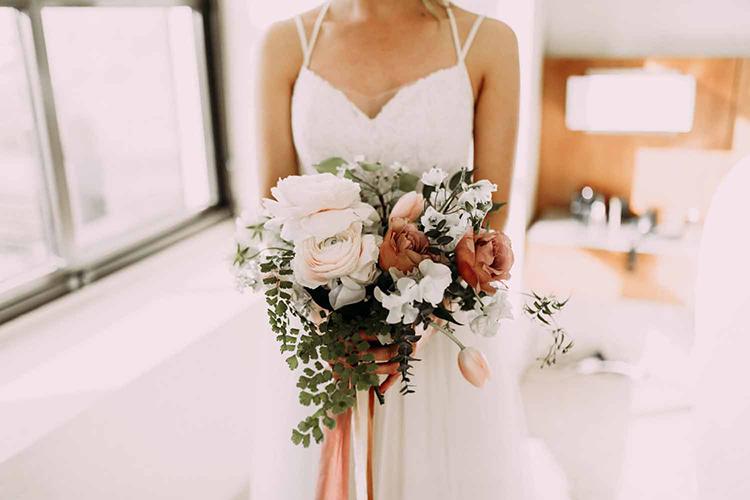 dusty pink bouquet - photo by By Amy Lynn Photography http://ruffledblog.com/industrial-loft-wedding-with-a-geometric-ceremony-backdrop
