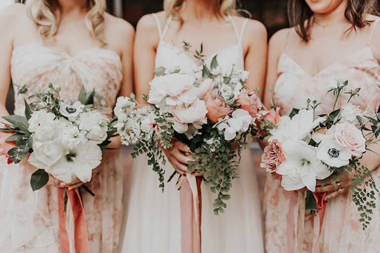 wedding bouquets with anemones - photo by By Amy Lynn Photography https://ruffledblog.com/industrial-loft-wedding-with-a-geometric-ceremony-backdrop
