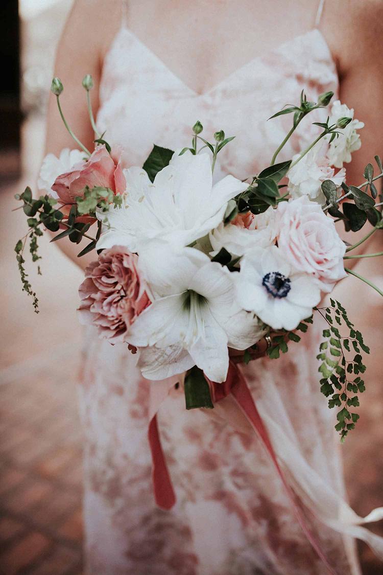 wedding bouquets with ranunculus - photo by By Amy Lynn Photography http://ruffledblog.com/industrial-loft-wedding-with-a-geometric-ceremony-backdrop