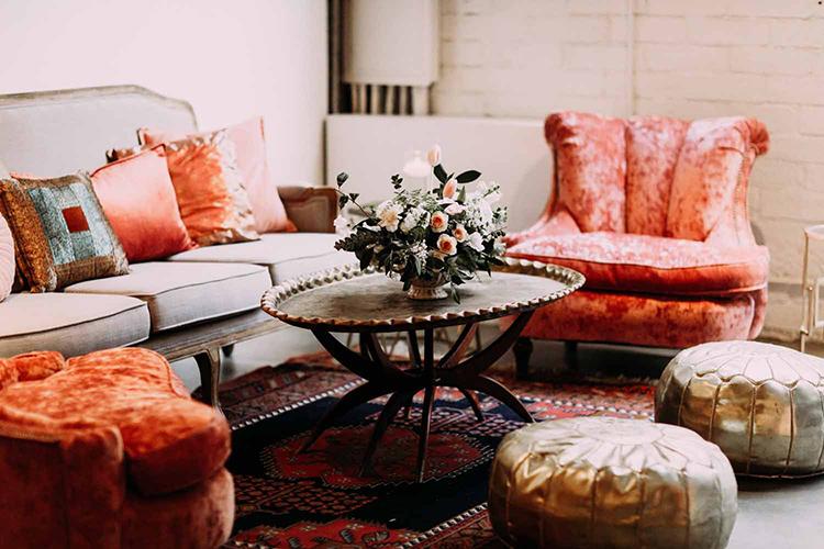 bohemian wedding lounges - photo by By Amy Lynn Photography https://ruffledblog.com/industrial-loft-wedding-with-a-geometric-ceremony-backdrop
