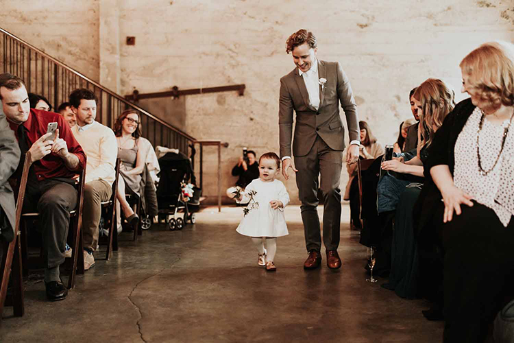 ceremony processionals - photo by By Amy Lynn Photography https://ruffledblog.com/industrial-loft-wedding-with-a-geometric-ceremony-backdrop