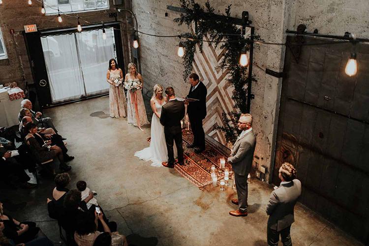 Luce Loft weddings - photo by By Amy Lynn Photography http://ruffledblog.com/industrial-loft-wedding-with-a-geometric-ceremony-backdrop