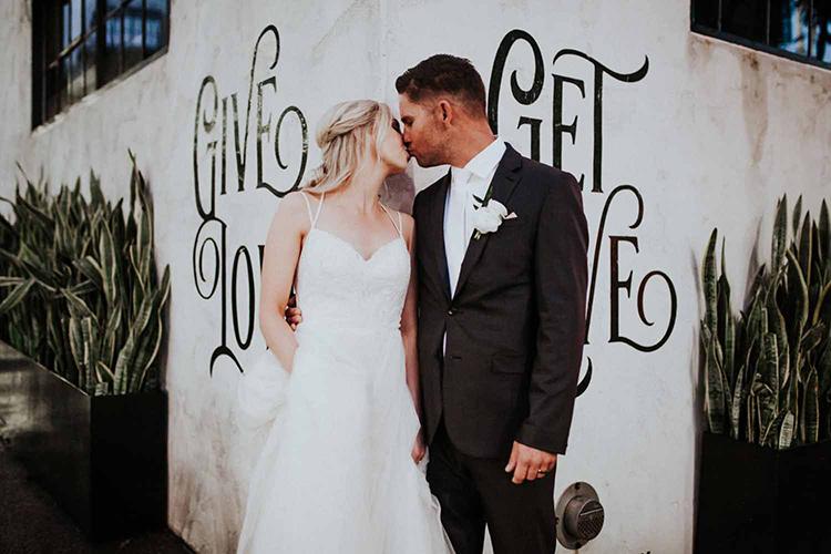 wedding portraits - photo by By Amy Lynn Photography http://ruffledblog.com/industrial-loft-wedding-with-a-geometric-ceremony-backdrop