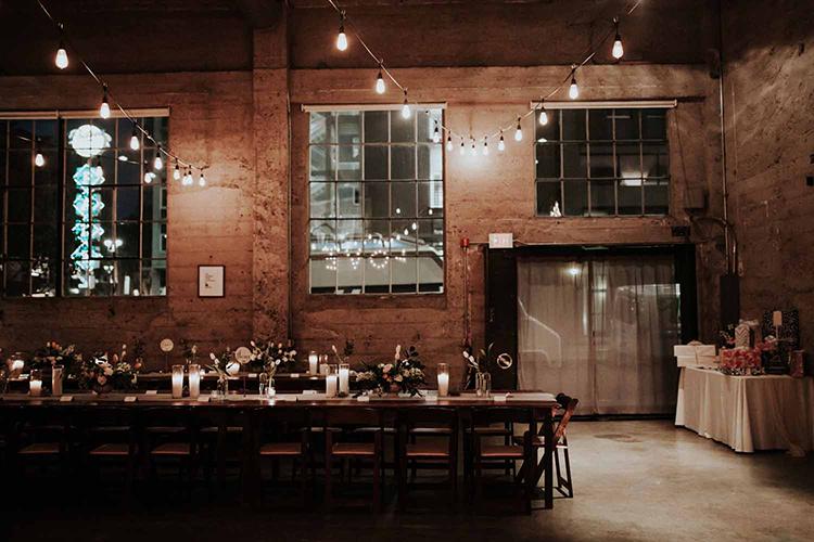 industrial loft weddings - photo by By Amy Lynn Photography http://ruffledblog.com/industrial-loft-wedding-with-a-geometric-ceremony-backdrop