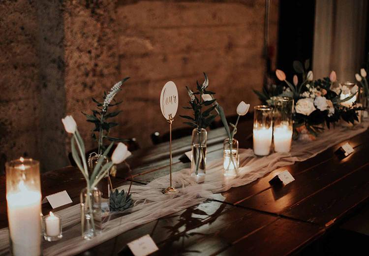 industrial modern wedding centerpieces - photo by By Amy Lynn Photography https://ruffledblog.com/industrial-loft-wedding-with-a-geometric-ceremony-backdrop