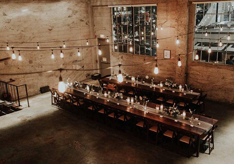 industrial loft wddings - photo by By Amy Lynn Photography http://ruffledblog.com/industrial-loft-wedding-with-a-geometric-ceremony-backdrop