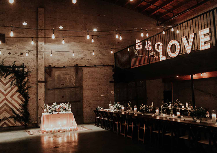 industrial loft wedding receptions - photo by By Amy Lynn Photography http://ruffledblog.com/industrial-loft-wedding-with-a-geometric-ceremony-backdrop