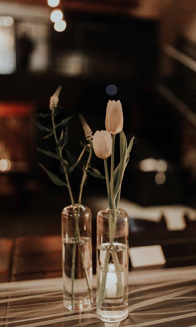 tulip bud vase centerpieces - photo by By Amy Lynn Photography http://ruffledblog.com/industrial-loft-wedding-with-a-geometric-ceremony-backdrop