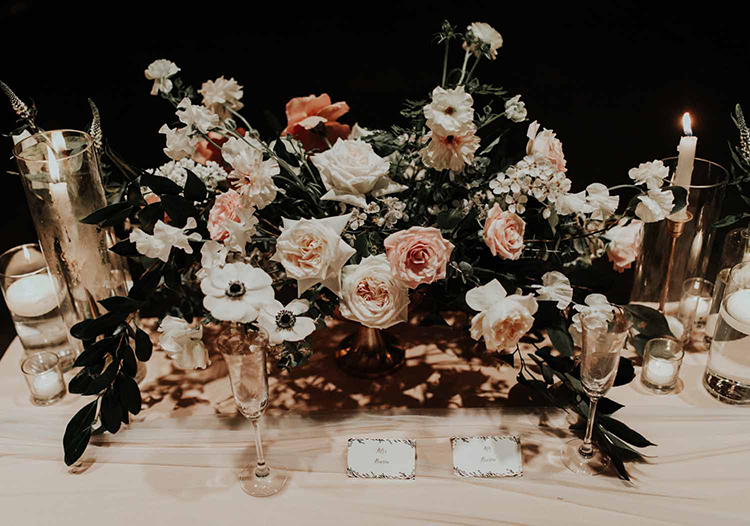 rose and anemone centerpieces - photo by By Amy Lynn Photography https://ruffledblog.com/industrial-loft-wedding-with-a-geometric-ceremony-backdrop