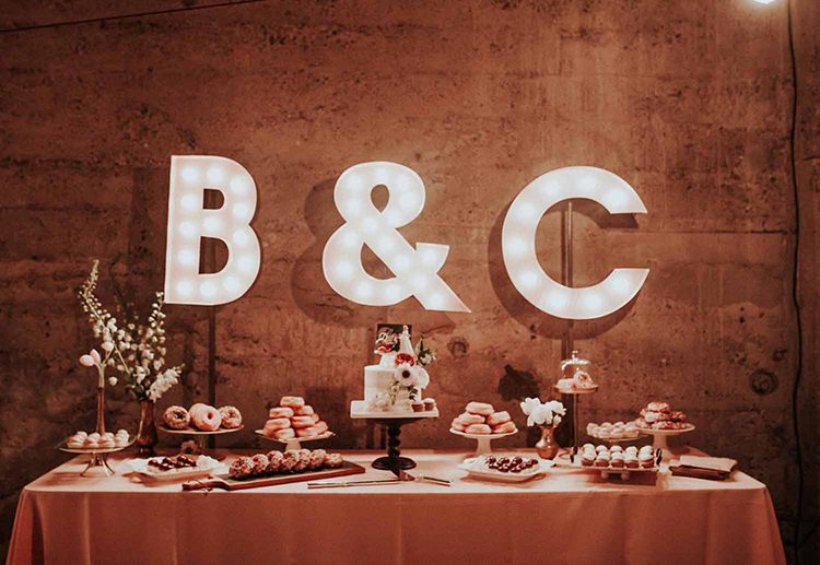 dessert tables - photo by By Amy Lynn Photography https://ruffledblog.com/industrial-loft-wedding-with-a-geometric-ceremony-backdrop