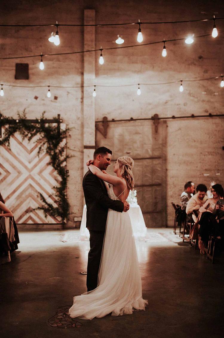 wedding dances - photo by By Amy Lynn Photography http://ruffledblog.com/industrial-loft-wedding-with-a-geometric-ceremony-backdrop