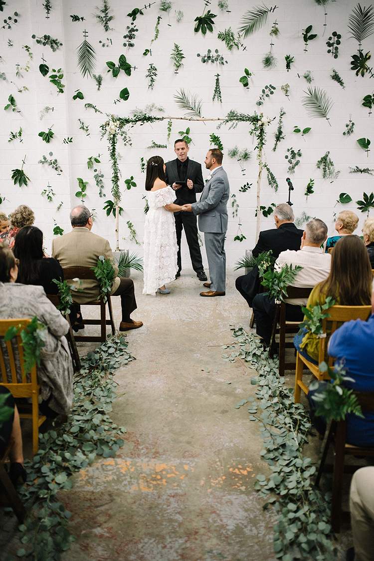 Industrial Modern Wedding with a Greenery Wall - photo by The Kama Photography http://ruffledblog.com/industrial-modern-wedding-with-a-greenery-wall