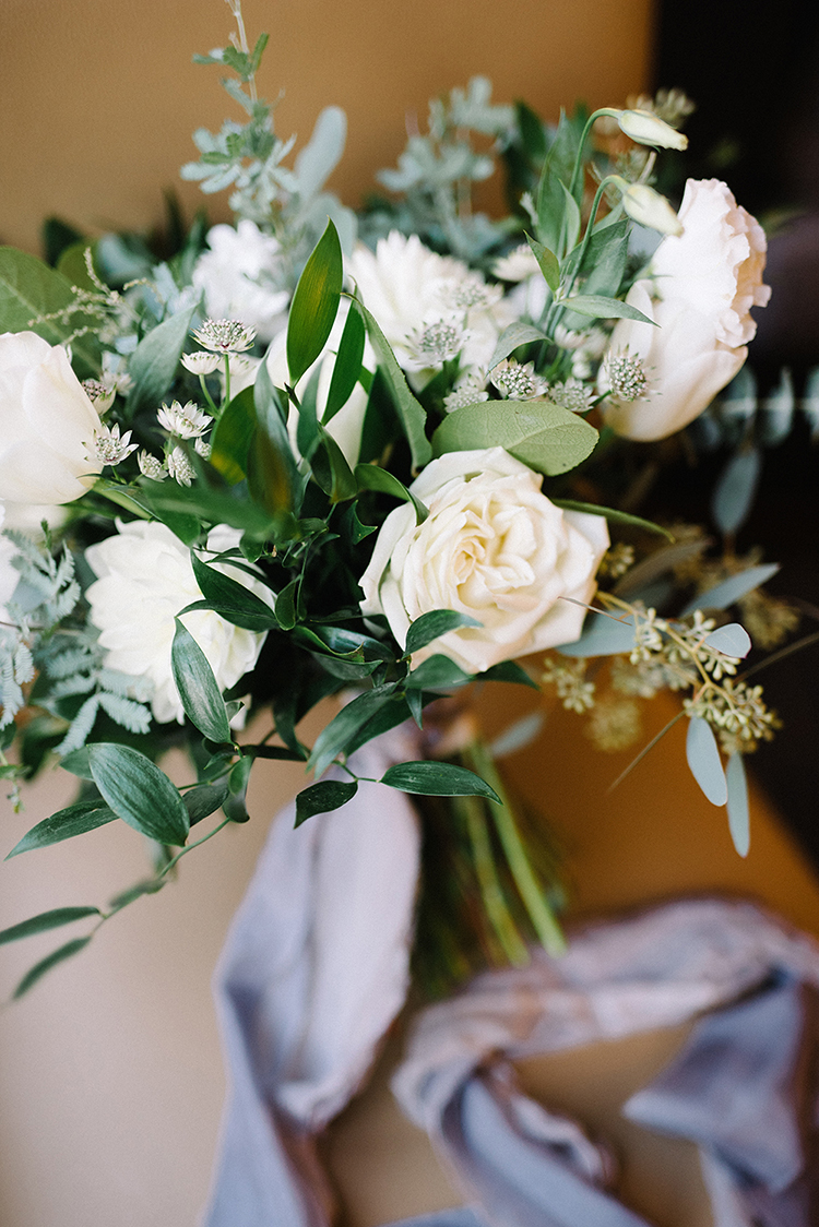 ivory bloom bouquets - photo by The Kama Photography https://ruffledblog.com/industrial-modern-wedding-with-a-greenery-wall