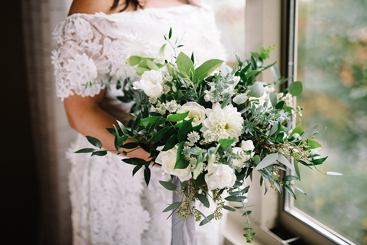leafy green and white bouquets - photo by The Kama Photography https://ruffledblog.com/industrial-modern-wedding-with-a-greenery-wall