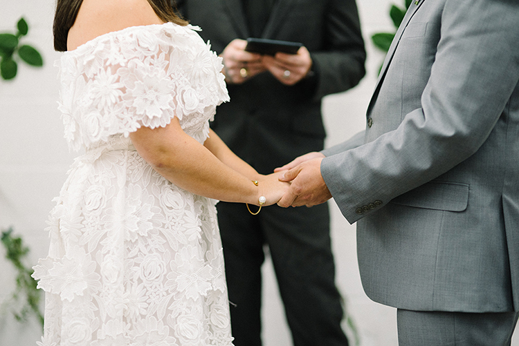wedding ceremonies - photo by The Kama Photography https://ruffledblog.com/industrial-modern-wedding-with-a-greenery-wall