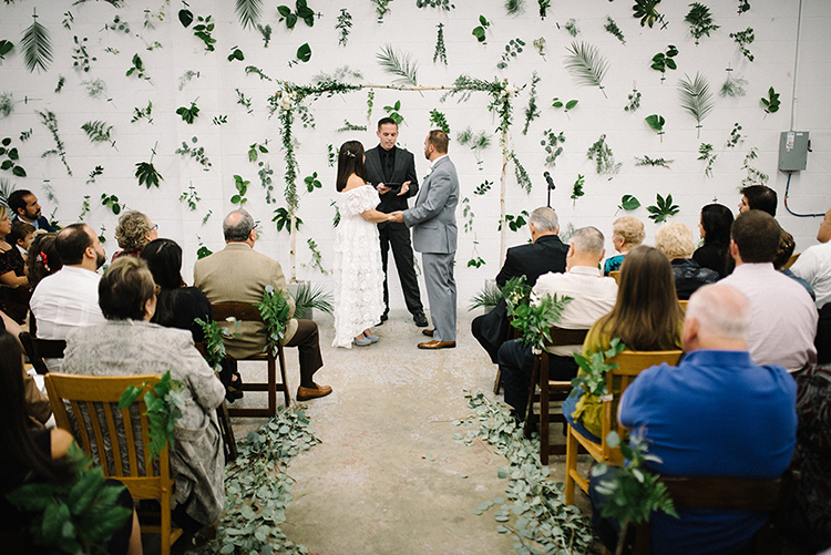 wedding ceremonies - photo by The Kama Photography http://ruffledblog.com/industrial-modern-wedding-with-a-greenery-wall