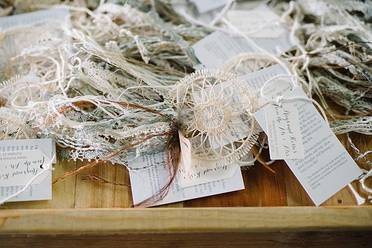 dreamcatcher wedding favors - photo by The Kama Photography https://ruffledblog.com/industrial-modern-wedding-with-a-greenery-wall