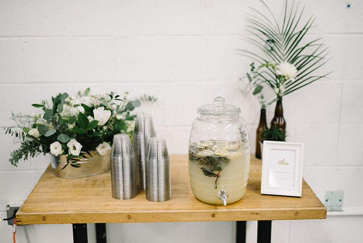 wedding drinks - photo by The Kama Photography https://ruffledblog.com/industrial-modern-wedding-with-a-greenery-wall