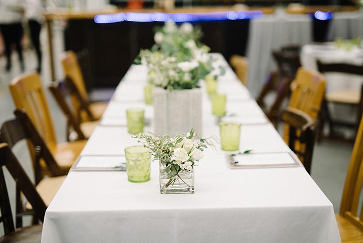 wedding tables - photo by The Kama Photography http://ruffledblog.com/industrial-modern-wedding-with-a-greenery-wall