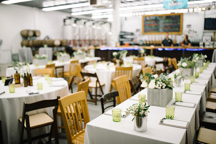 industrial wedding receptions - photo by The Kama Photography https://ruffledblog.com/industrial-modern-wedding-with-a-greenery-wall