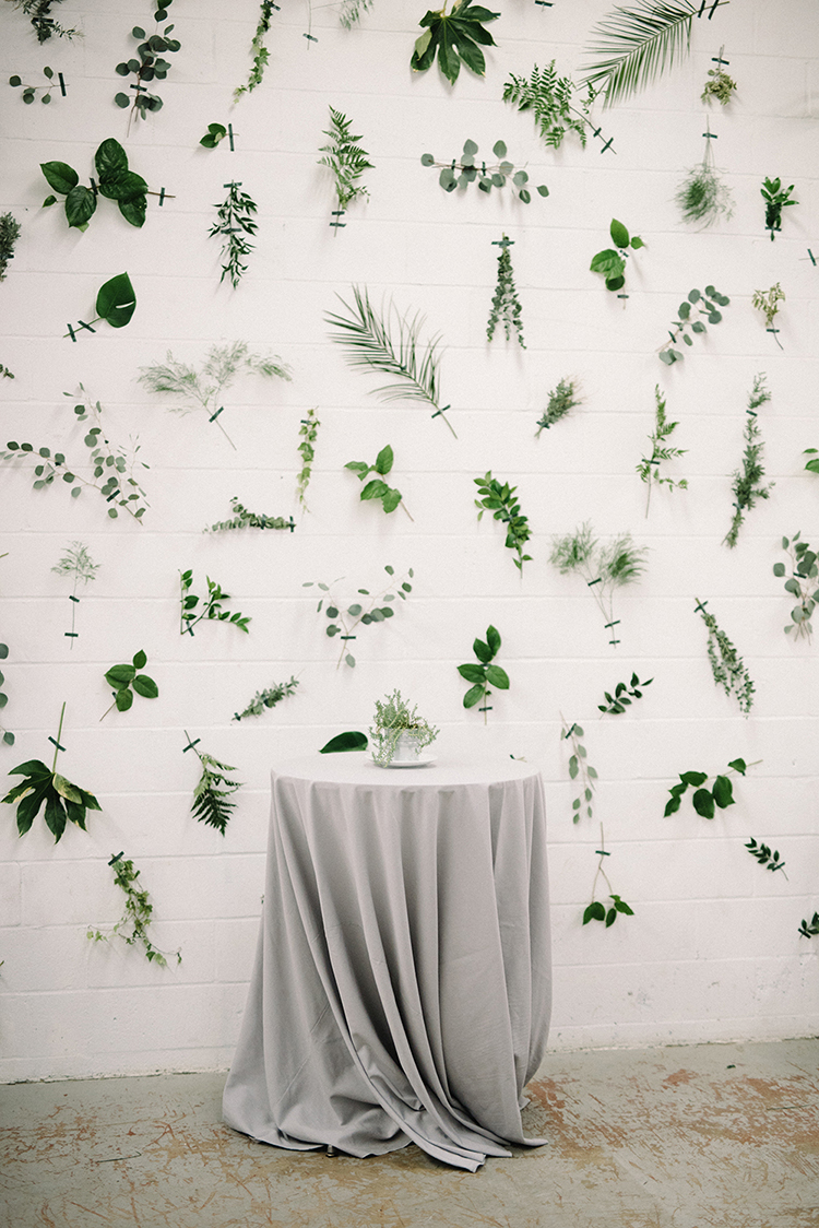 cocktail hour displays - photo by The Kama Photography http://ruffledblog.com/industrial-modern-wedding-with-a-greenery-wall