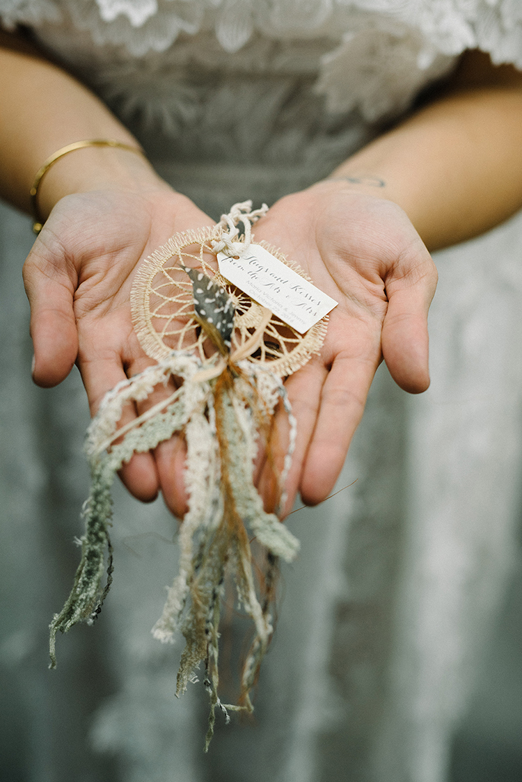 dreamcatcher wedding favors - photo by The Kama Photography http://ruffledblog.com/industrial-modern-wedding-with-a-greenery-wall