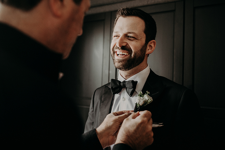 groom getting ready - photo by Scarlet ONeill https://ruffledblog.com/industrial-space-meets-enchanted-forest-wedding