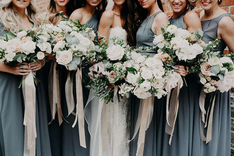 bridesmaid bouquets - photo by Scarlet ONeill http://ruffledblog.com/industrial-space-meets-enchanted-forest-wedding