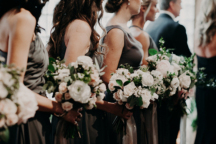 bridesmaid bouquets - photo by Scarlet ONeill https://ruffledblog.com/industrial-space-meets-enchanted-forest-wedding
