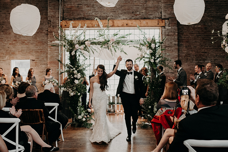 ceremony recessionals - photo by Scarlet ONeill https://ruffledblog.com/industrial-space-meets-enchanted-forest-wedding